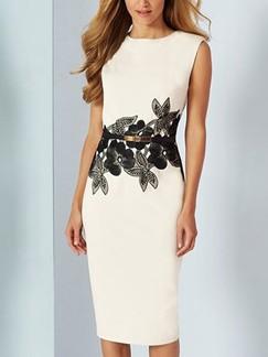 plus size tea length cocktail dress with floral detail